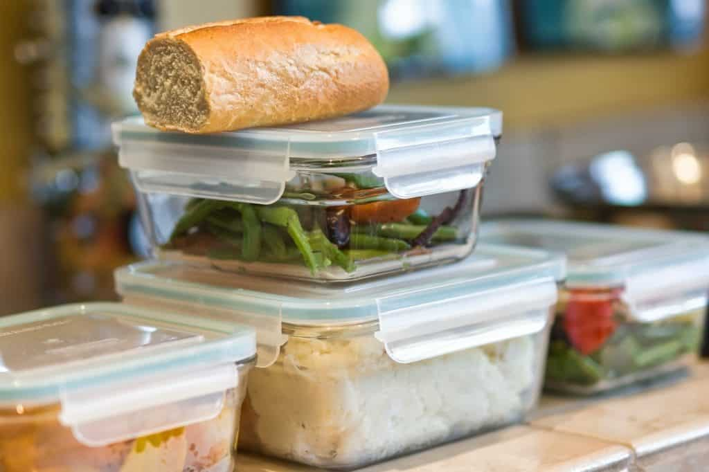 Close-up of containers of leftovers stacked on kitchen counter