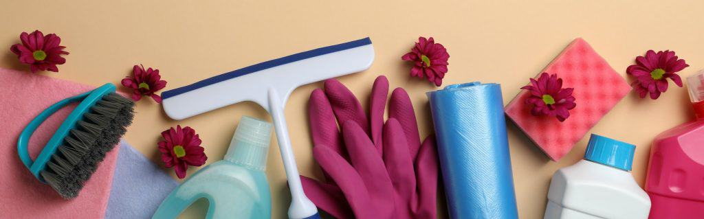 Different cleaning tools on beige background, top view